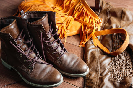 Womens clothing and accessories - shoes, bag, leather jacket bright wooden surface Stock Photo