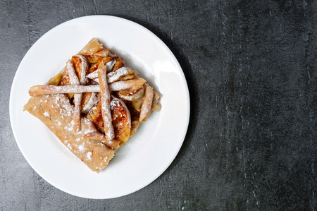 jewish home: Apple galette, pie, tart with cinnamon on a grey stone background Top view