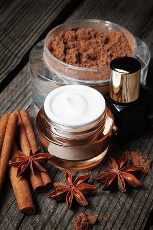 moisturize: Chocolate skin treatment. Cosmetic jar with lotion, cocoa, anise, cinnamon sticks.