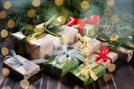 Stack of gift box by Christmas tree. Closeup. Stock Photo