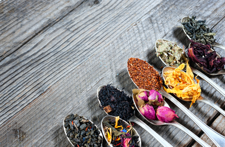 The different kinds of tea presented as a sample in the silver spoons, top view