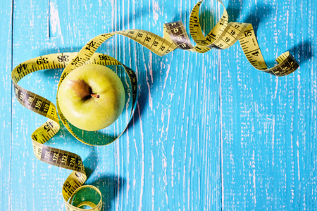 Apple with a measuring tape around it top view Stock Photo