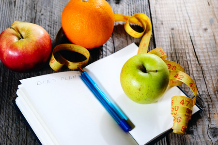 Fruits and inscription diet plan. Slim down eating plan. Healthy eating and fitness. Weight loss through healthy nutrition. Easy way to get fit.