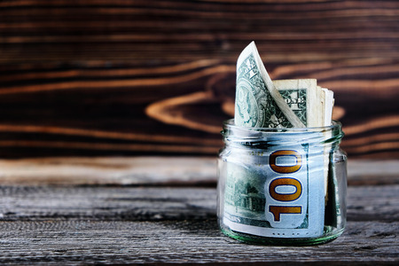 saving money in jar with American dollors , cash