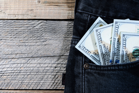 A one hundred dollar notes in the front pocket of denim trousers, copyspace Stock Photo