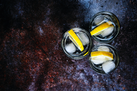 Vodka. Shots, glasses with vodka with ice .Dark stone background. Copy space. Stock Photo