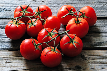 Delicious red tomatoes. Summer tray market agriculture farm full of organic vegetables.