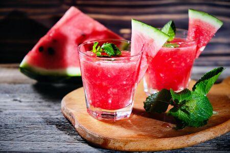Watermelon Mojito with Watermelon Garnish on wooden table