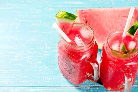 Colorful refreshing drinks for summer, cold watermelon lemonade juice smoothies in the glasses Reklamní fotografie