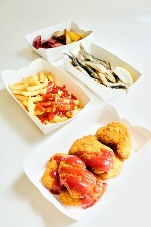 fast food and unhealthy eating concept - close up of fast food snacks Reklamní fotografie