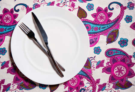 White plate, cutlery and napkin. Table setting.