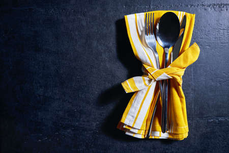 cutlery and napkin on stone table. Table setting. 스톡 콘텐츠