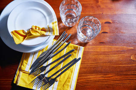 Tableware and decorations for serving a festive table. Plates, glasses and cutlery with decorative textile top view Reklamní fotografie