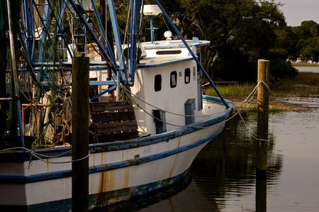 Shrimp boat tied to a dock Stock Photo