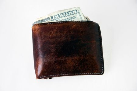 Wallet with a one million dollar bill hanging out Banco de Imagens