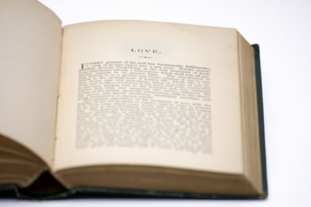 Chapter section of an old worn book titled love Stock Photo