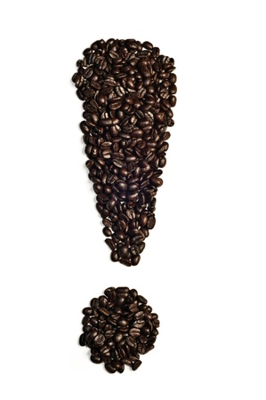 configured: loud coffee beans configured in the shape of an exclamation point