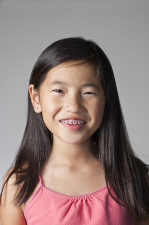 cute braces: pretty smiling Chinese girl with new braces
