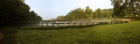 panarama shot of a wooden bridge at the edge of the Chattahoochee River