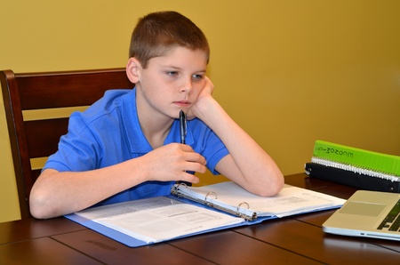 young student perplexed over a homework problem Stock Photo