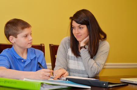 teaching: Tutor challenges her student in understanding a problem Stock Photo