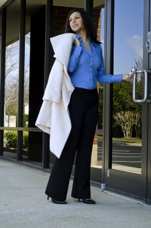 attractive business woman walking into her office Stock Photo