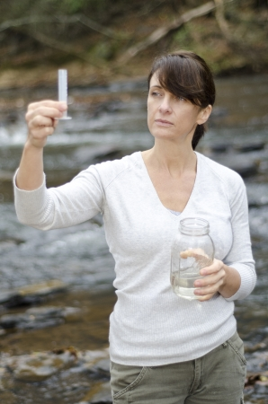 Scientist looking at the water sample she too from the river