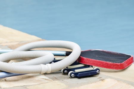 equipment: equipment needed to clean the pool is ready to go Stock Photo