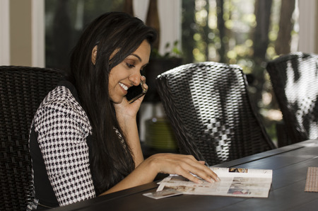 Attractive young Indian business woman places an order photo