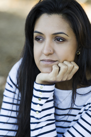 Pretty young Indian woman thinking over her problms