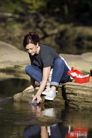 samples: biologist get a water sample for the river