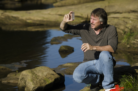 scientist checks the water quality in a river