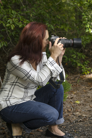 quietly: attractive photographer quietly setting up the perfect shot Stock Photo