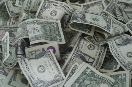 Big stack of random dollar bills on top of eachother Imagens
