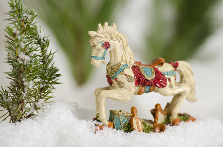 Antique Christmas ornimental horse in the snow
