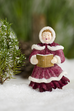Christmas ornament singing carols in the snow Reklamní fotografie