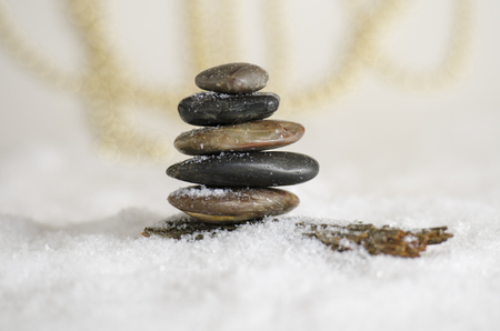 Stack of meditative rocks in the snow