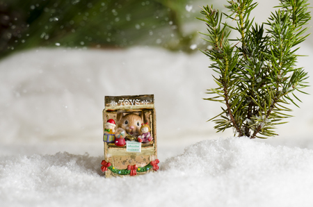 Mouse Christmas ornament in the snow