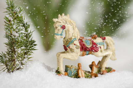 Antique Christmas ornamental horse in the falling snow Stock Photo