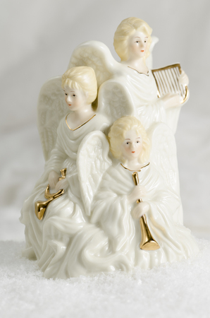 Three ceramic Christmas angels and their onstruments Stock Photo