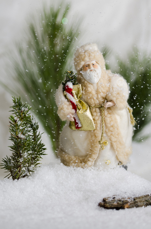Santa Christmas ornament in the snow fall