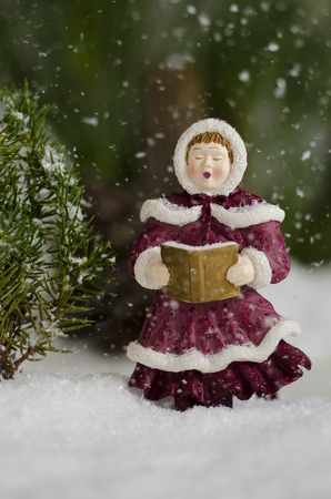 Singing carols in the snow fall