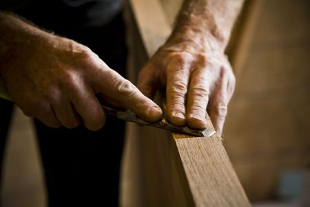craft work: Close-up of man doing carpentry. Horizontally framed shot.