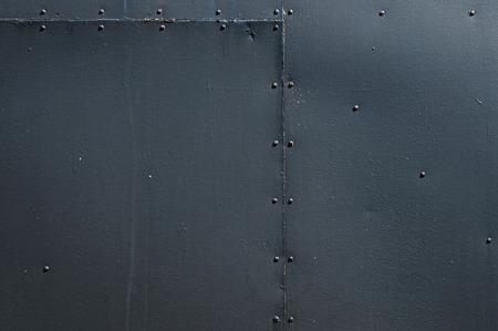 ブラックのリベットで留められた板金の背景