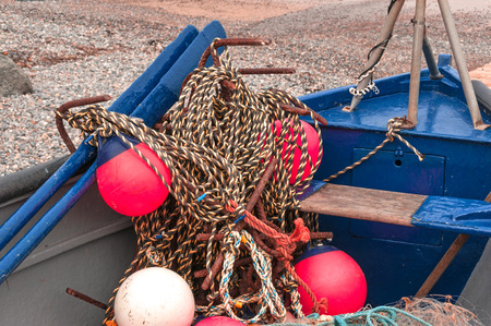 trawler net: Traditional Fishing Boat with Nets and Bouys