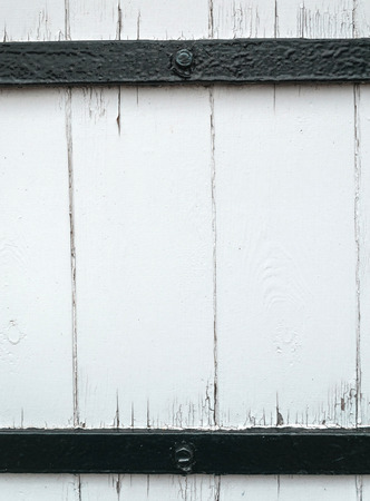 vaulted door: Rough Worn White Painted Wood Plank Background Framed Black Bars