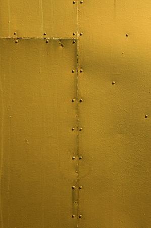 riveted metal: Golden Riveted Sheet Metal Background