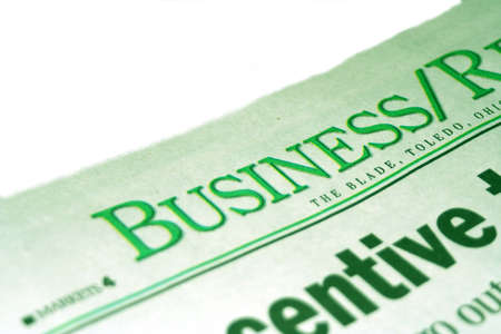 inform information: Business section of the newspaper with green tint Stock Photo