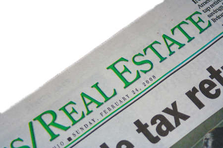 inform information: Real Estate section of the newspaper on white background