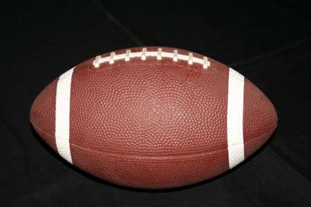 Football isolé sur un fond noir Banque d'images - 4829679